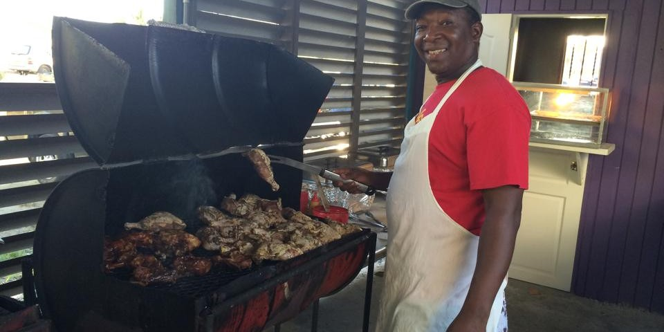 jerk master peter grilling the best barbeque at trellis bay full moon party