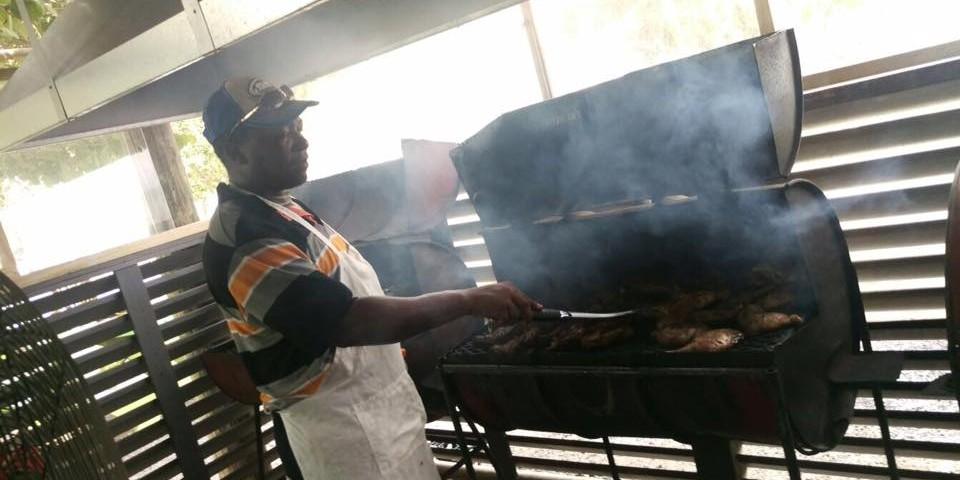 trellis bay market chef grilling at trellis bay full moon party