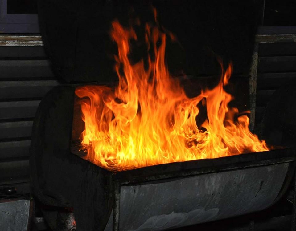 flaming charcoal grill at trellis bay market grill