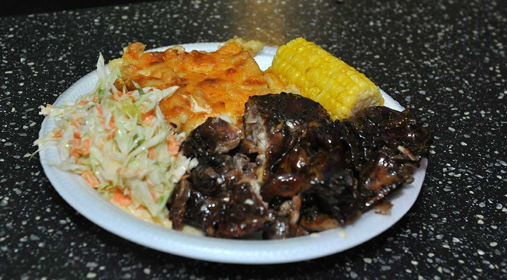 delicious plate of bbq chicken , macaroni pic, corn on the cob and coleslaw available every weekend at trellis bay market