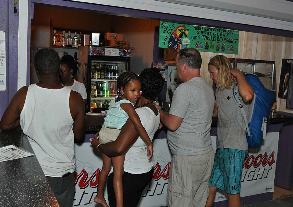 customers awaiting their order at trellis bay market bar and grill