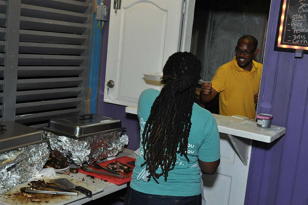 workers at trellis bay market exchanging smiles