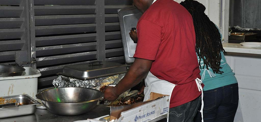 Chefs preparing jerk and BBQ meals