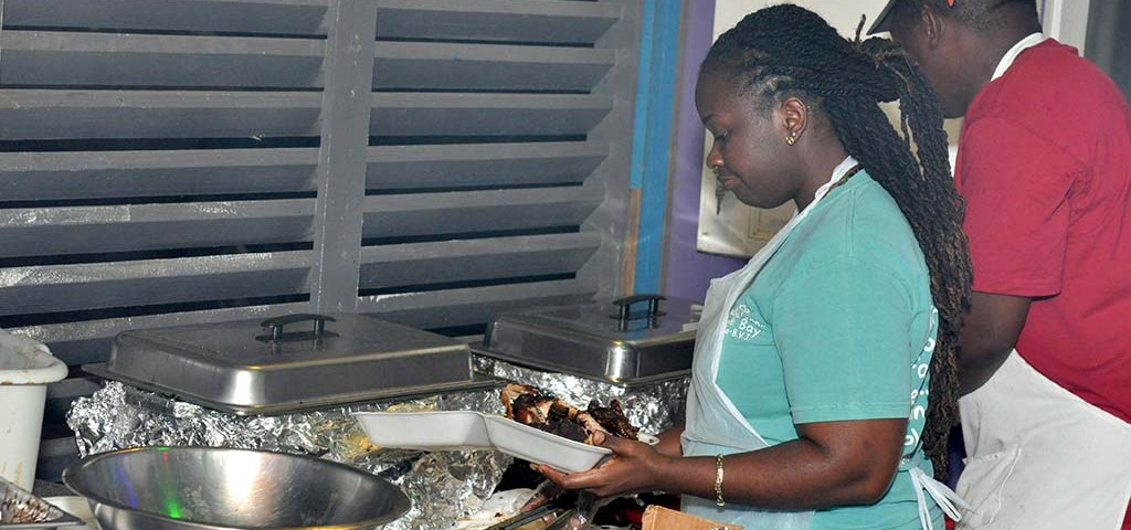 Chefs preparing jerk and BBQ dinner