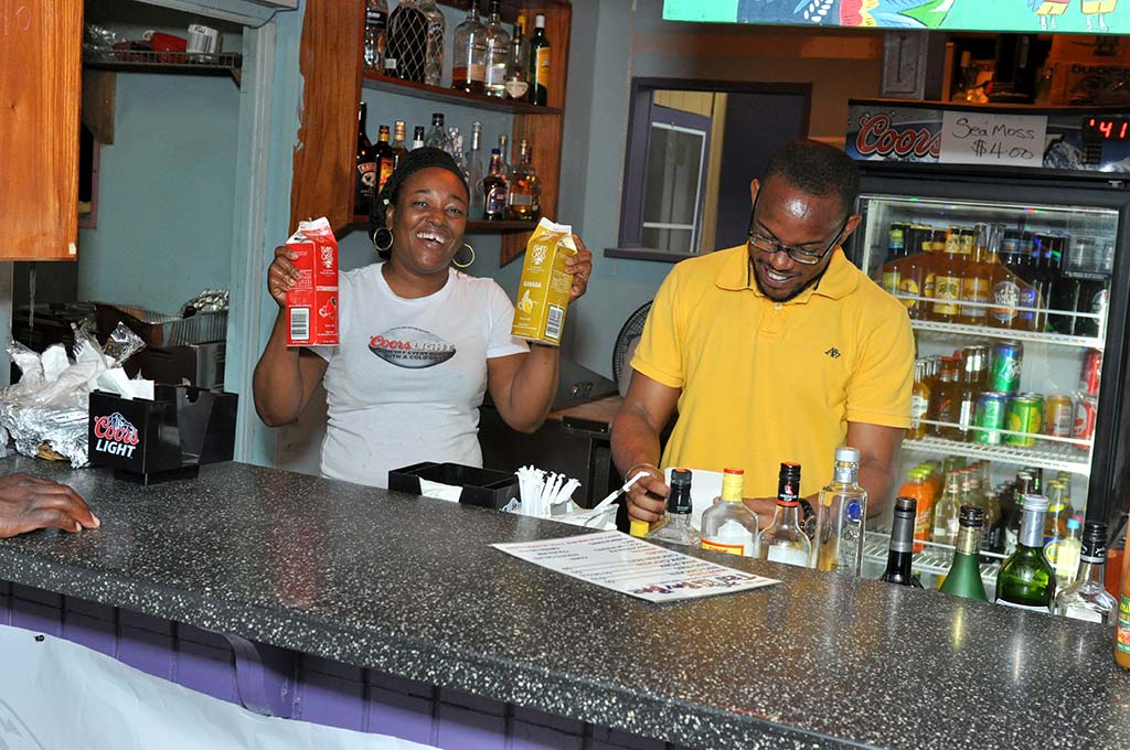 workers having some trellis bay fun behind the bar