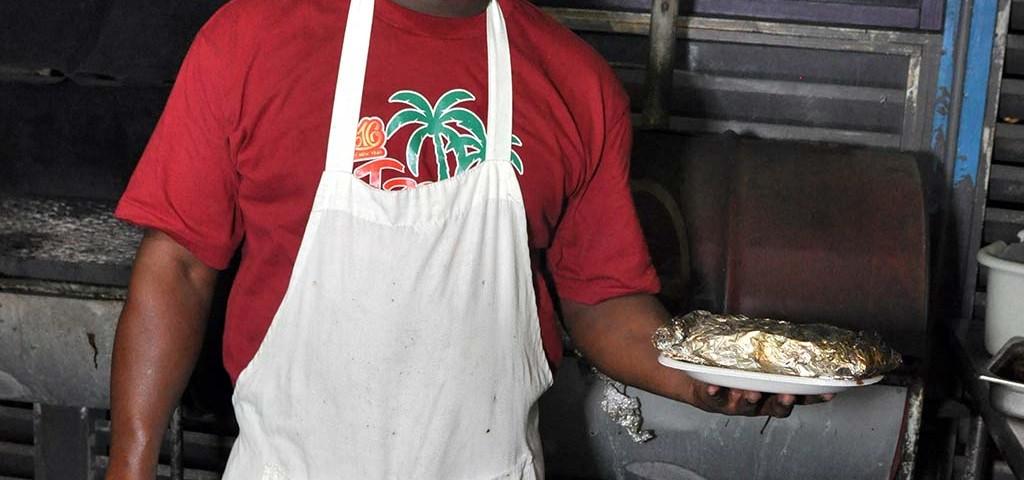 trellis bay market grill master serving grilled fish