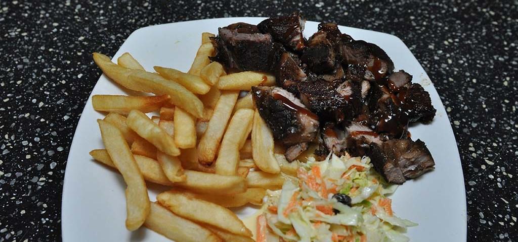 tasty jerk pork plate at trellis bay market
