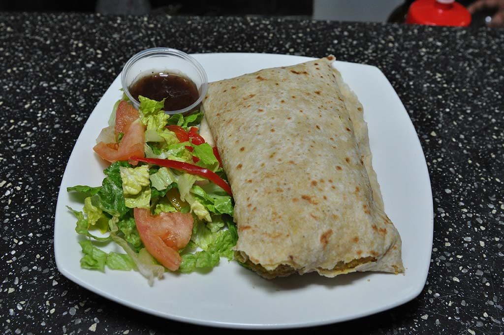 trellis bay market award winning chicken roti served with green salad and mango chutney