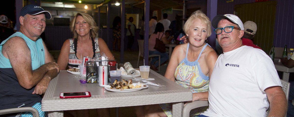 visitors enjoying the full moon party at trellis bay market