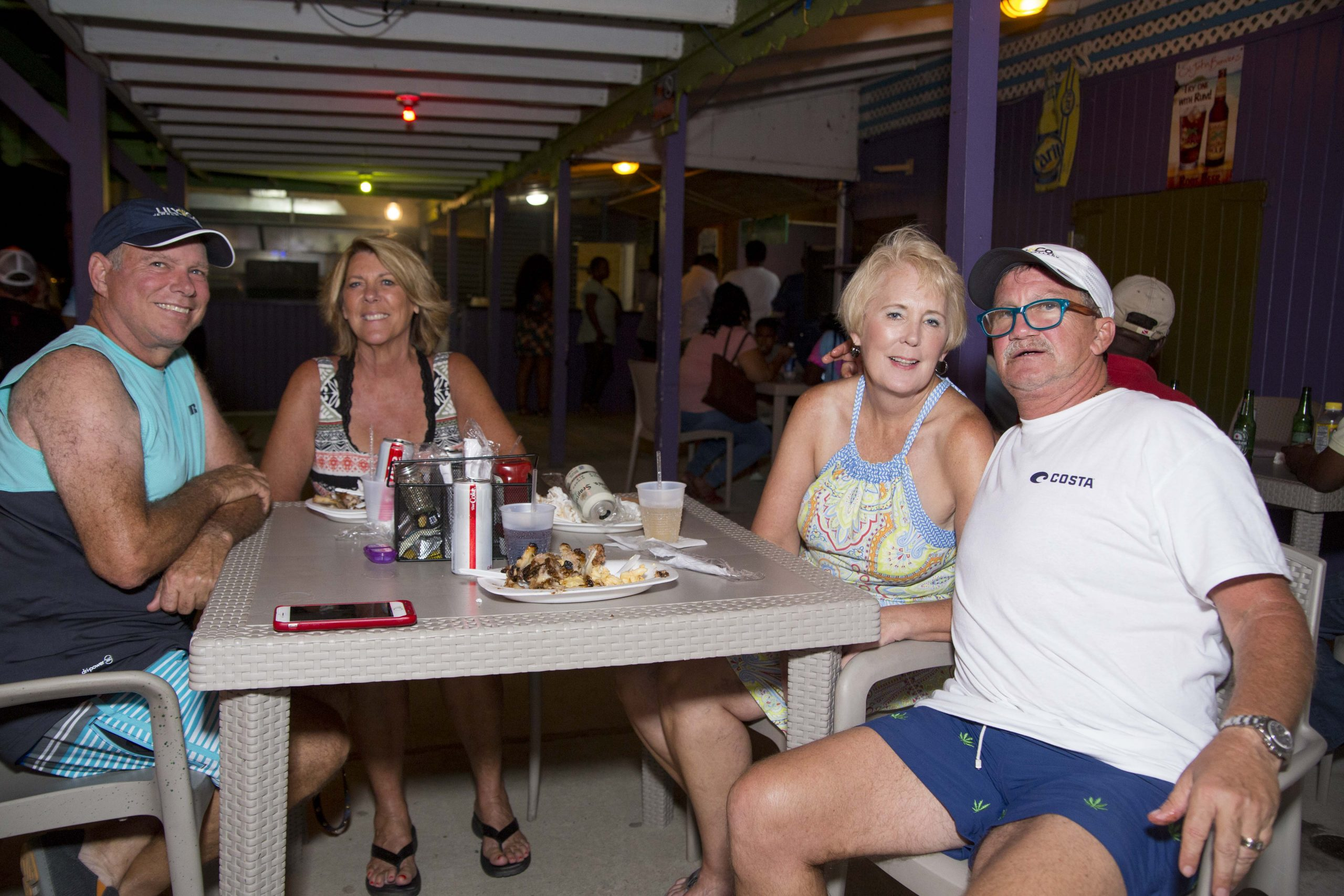 visitors enjoying the full moon party at trellis bay market