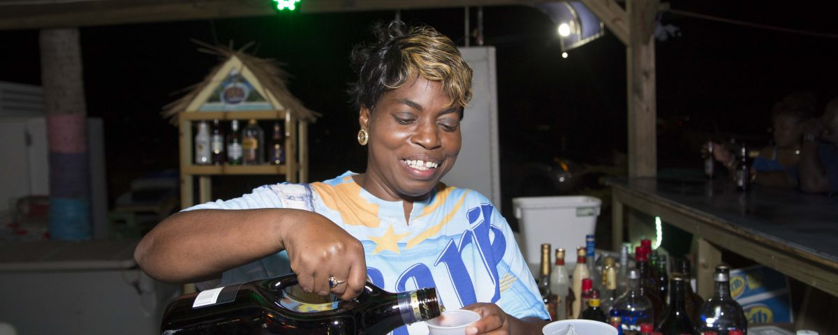 Paula serving a specialty cocktail at carib specials at cheers at vybez & chill at trellis bay market